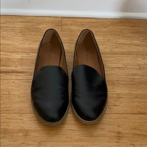 Black leather loafer style flats